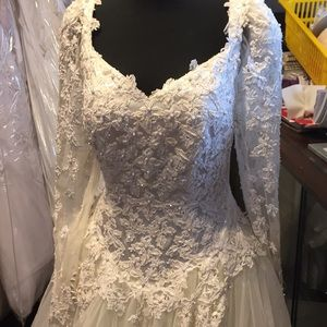 Beautiful vintage wedding gown with long sleeves